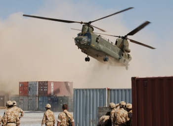 Helicopter Landing at Desert Base